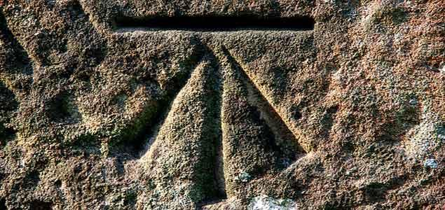 The Ordnance Survey benchmark symbol | Image credit: Chalto/Flickr.